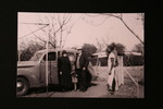 Elderly Carl and Dorothea Hoffmann in front of car