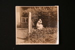 Elderly Dorothea Hoffmann working in garden